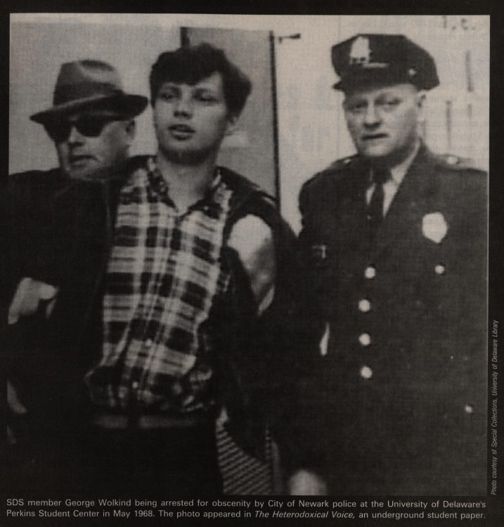 SDS member George Wolkind being arrested for obscenity by City of Newark police at the UD Perkins Student Center, 1968 May