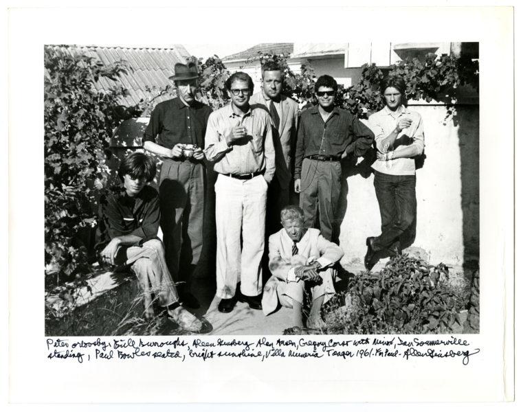 Peter Orlovsky, Bill Burroughs, Allen Ginsberg, Alan Ansen, Gregory Corso with Minox, Ian Sommerville standing, Paul Bowles seated, bright sunshine, Villa Muneria [sic] 1961