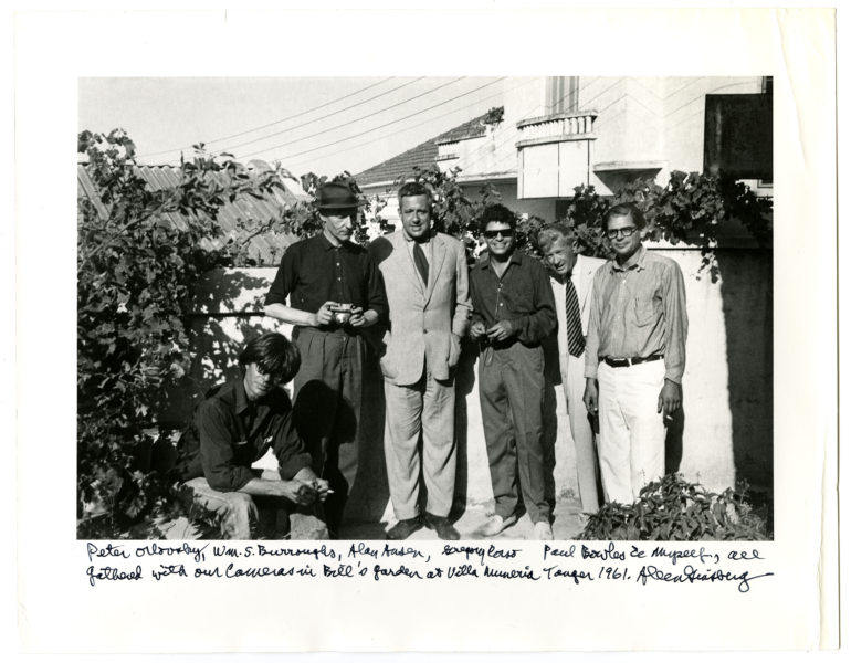 Peter Orlovsky, Wm. S. Burroughs, Alan Ansen, Gregory Corso, Paul Bowles & Myself, all gathered with our cameras in Bill's garden at Villa Muneria [sic] Tanger 1961