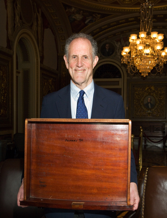 Photograph of Ted Kaufman holding the drawer to Senate desk XCI, 2009 April 7