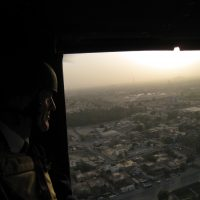 Thumbnail: Photograph of Senator Kaufman in a helicopter above the Iraqi capital city of Baghdad, 2009 August-September