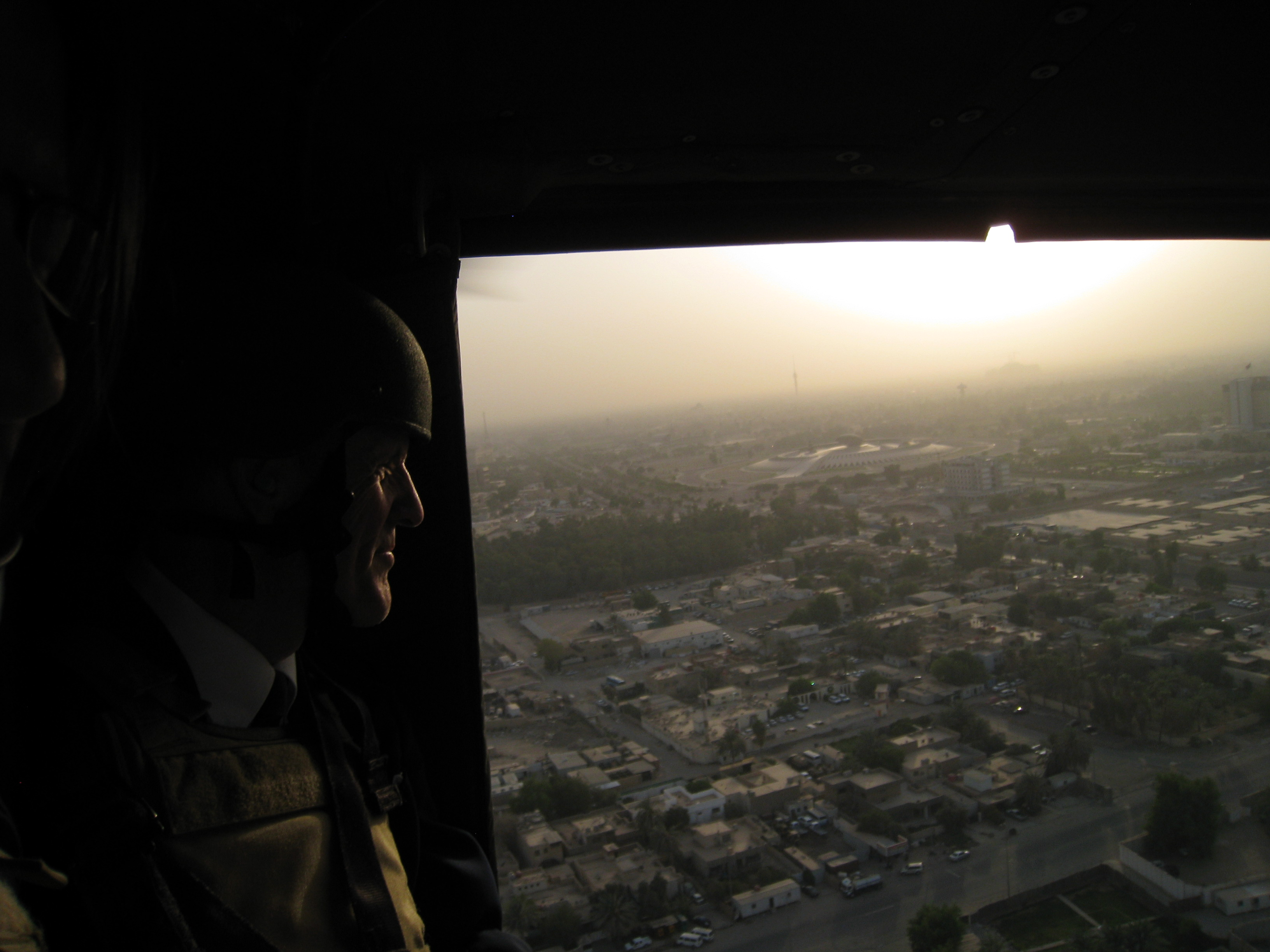 Photograph of Senator Kaufman in a helicopter above the Iraqi capital city of Baghdad, 2009 August-September