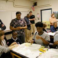 Thumbnail: Photograph of Senator Kaufman with students at Serviam Girls Academy, 2010 May 14