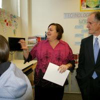 Thumbnail: Photograph of Senator Kaufman with teacher and student at John Dickinson High School, 2010 February 18