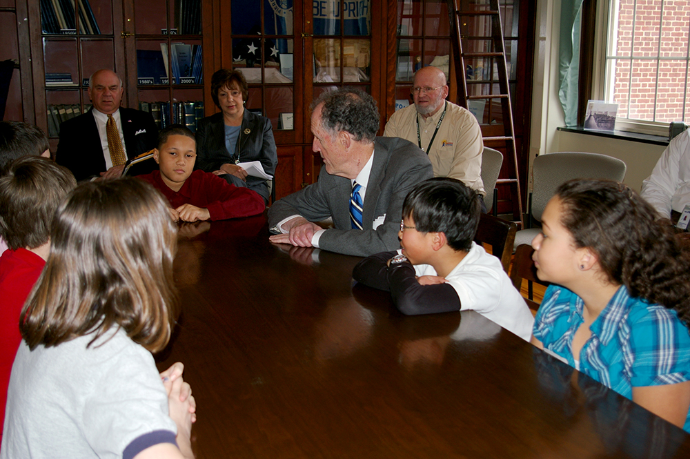 Photograph of Senator Ted Kaufman with students at P.S. duPont Middle School, 2010 March 1 2