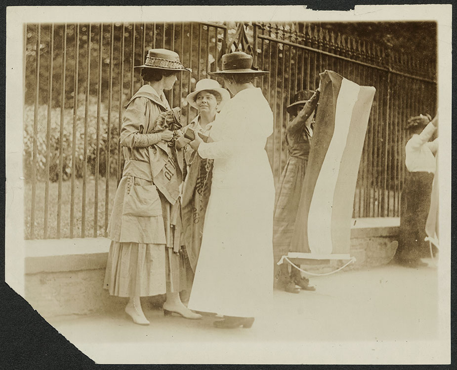 Policewoman arrests Florence Youmans of Minnesota and Annie Arniel (center) for refusing to give up their banners (photograph), June 1917. National Woman's Party Records. Facsimile image courtesy Library of Congress