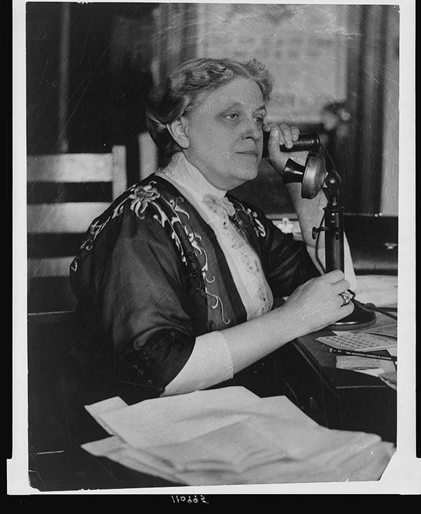 Carrie Chapman Catt, half-length portrait, seated, facing left, on telephone, 1909. National Photo Company collection. Facsimile image courtesy of Library of Congress