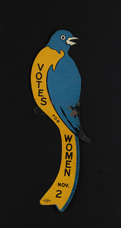"Massachusetts Woman Suffrage Association. ""Votes for Women Nov. 2"" [tin blue bird sign], 1915. Woman Suffrage Collection"